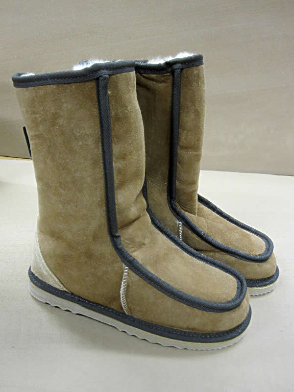 Sno UGG boots. Popular calf length medium Sheepskin UGG Boot, with tongue front