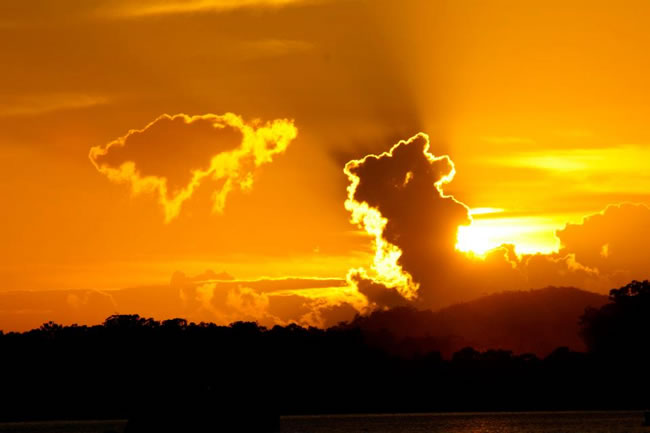 WOW! Brilliant sunrise lights up the sky. Gladstone Harbour, Queensland, Australia