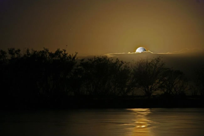 A full moon over Tannum Sands, near Gladstone, Queensland, Australia