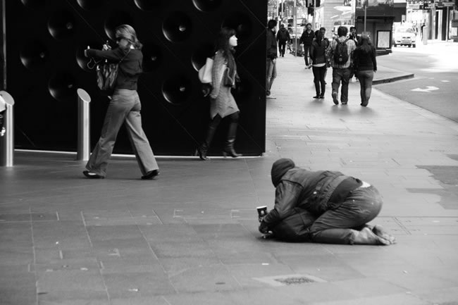 Also on the streets of Sydney - a street beggar. Sydney, New South Wales, Australia