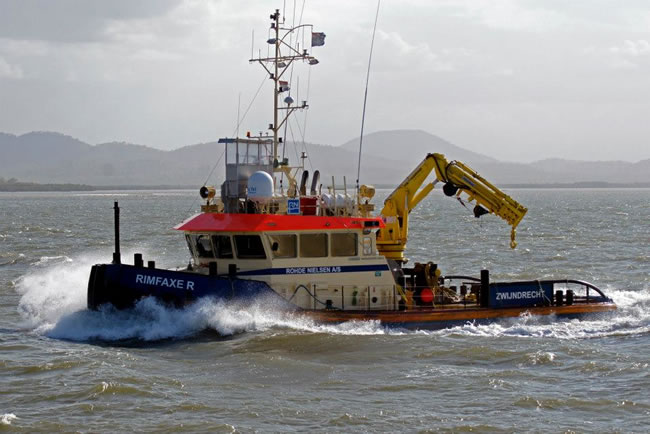 The tug 'Rimfaxer' on the way to work. Gladstone Harbour, Queensland, Australia