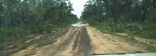 A road on the Tiwi Islands. Not a problem in the Dry, but during the Wet they can become impassable. Which makes getting kids to school a challenge! Four wheel drives replace buses.