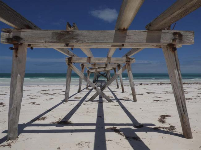 Looking underneath the abandoned jetty from the land, at Eucla, Western Australia